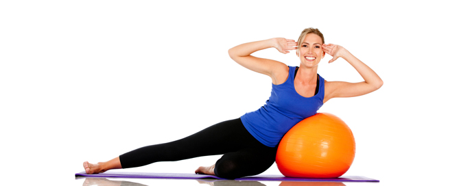 Pilates on side with Orange Ball